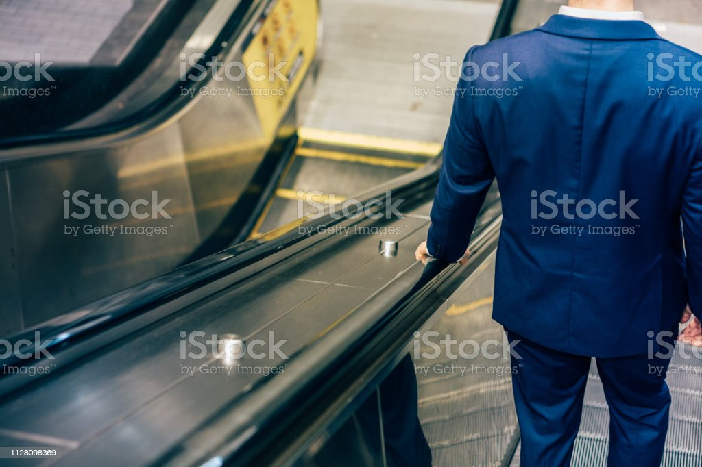 annonymous Businessman on the move stock photo