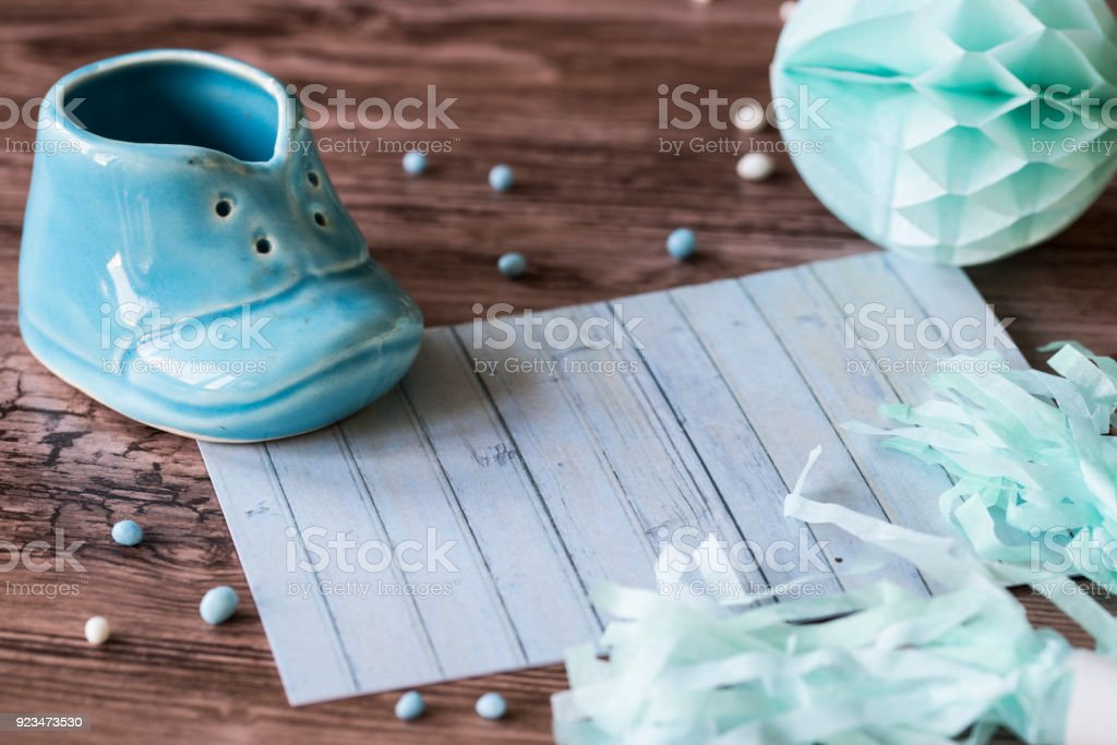 announcement baby boy is born, blue shoe, honeycomb and garland, space for text stock photo