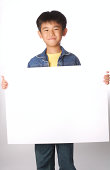 Boy with a blank sign.