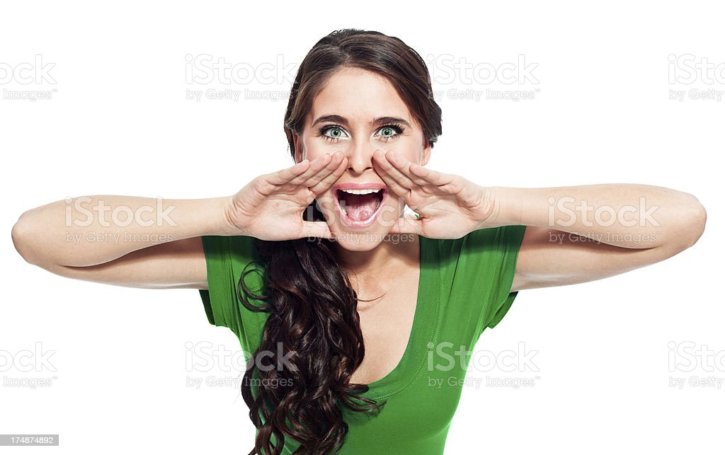 Announcement Portrait of beautiful young woman screaming at the camera. 20-24 Years Stock Photo
