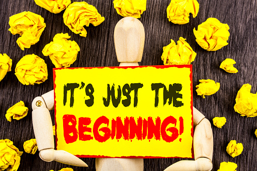istock Announcement text showing It Is Just The Beginning. Concept meaning Goal Success Plan For New Dream Life Career written on Sticky Note Holding By Sculpture on the wooden background 947071728