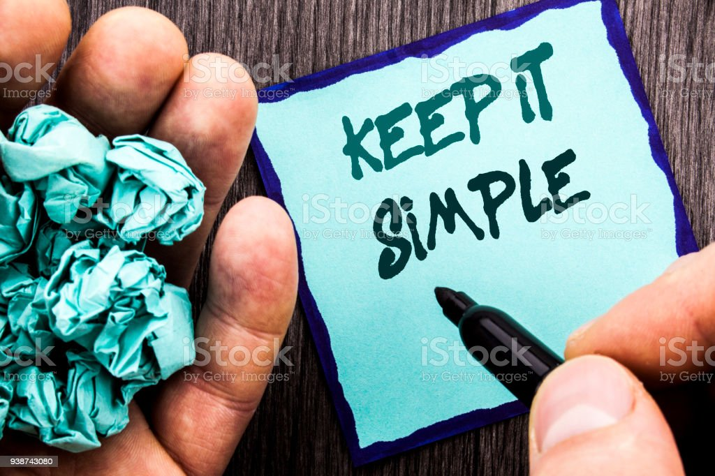 Announcement text showing Keep It Simple. Business concept for Simplicity Easy Strategy Approach Principle written on Notebook Book Man Writing Holding Pen wooden background. stock photo