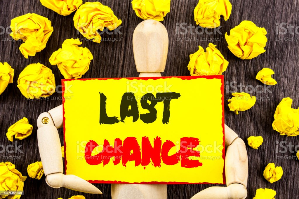 Announcement text showing Last Chance. Concept meaning Announcement Alert Time or Deadline Ending written on Sticky Note Holding By Sculpture on the wooden background stock photo