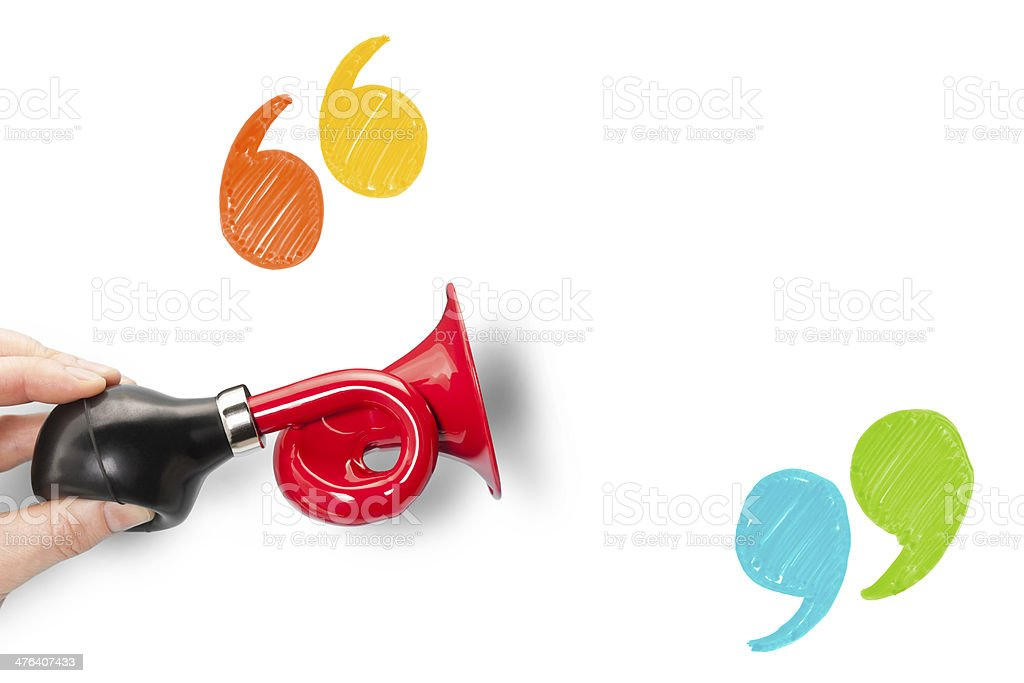 Announcement trumpet and quote marks with blank space stock photo