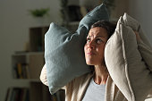 istock Annoyed adult woman suffering neighbour noise at night at home 1222946109