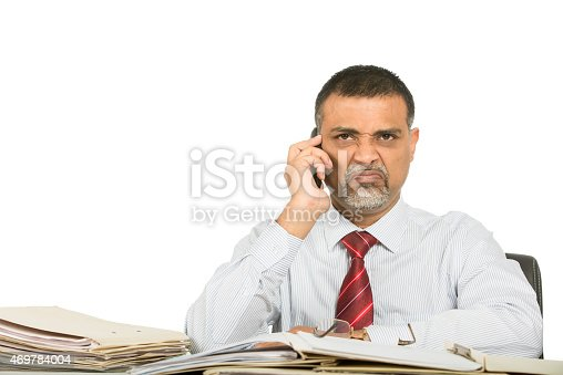 865714662istockphoto Annoyed and angry businessman on phone 469784004