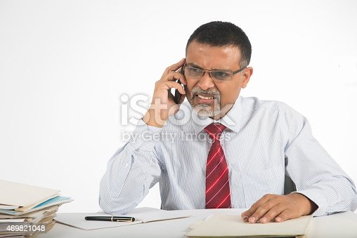 865714662istockphoto Annoyed and angry businessman on phone 469821048