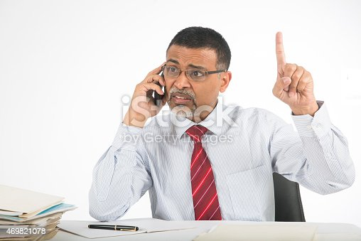 865714662istockphoto Annoyed and angry businessman on phone 469821078