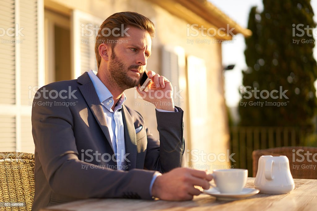 annoyed business man with mobile phone during breakfast foto stock royalty-free