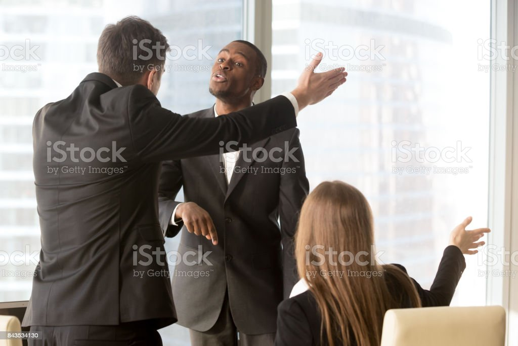 Annoyed business partners arguing during meeting stock photo
