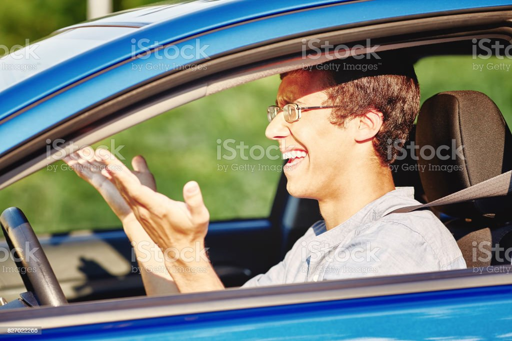 Annoyed guy in car stock photo