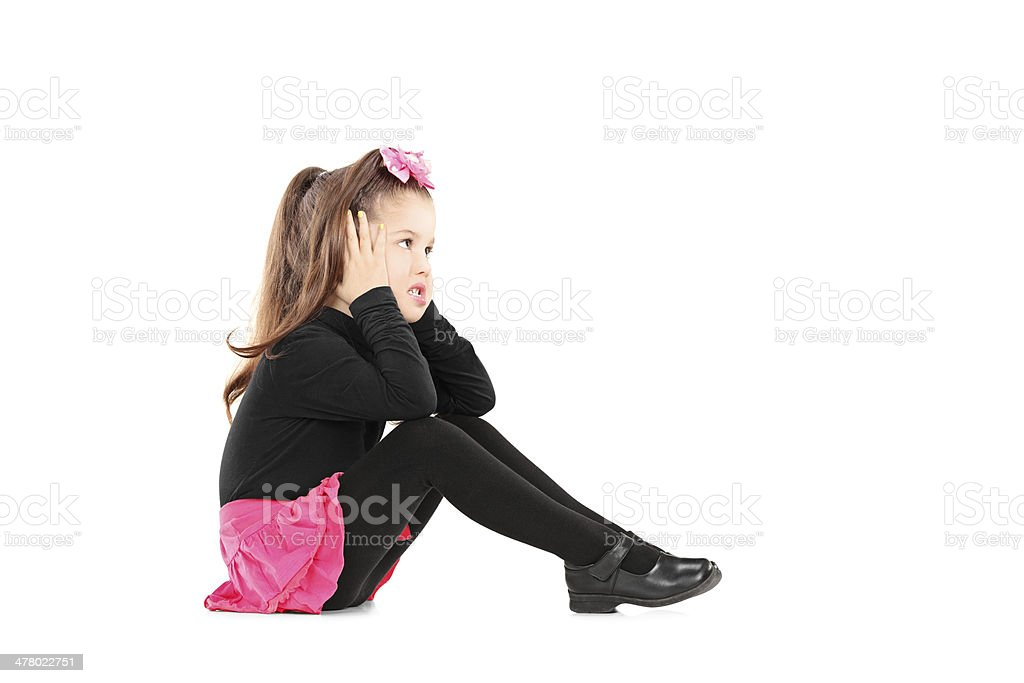 Annoyed little girl covering her ears stock photo