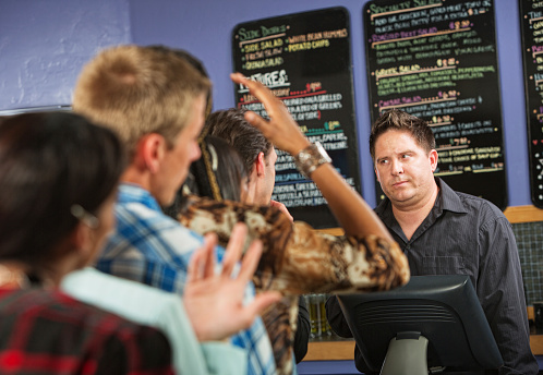 Annoyed Male Cafe Worker Stock Photo - Download Image Now