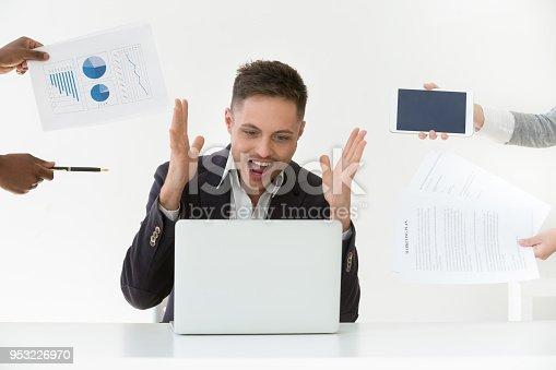 istock Annoyed overwhelmed businessman screaming feeling stressed, hates multi task work 953226970