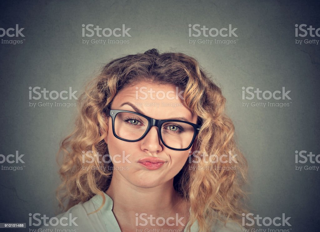 Annoyed woman looking skeptic stock photo