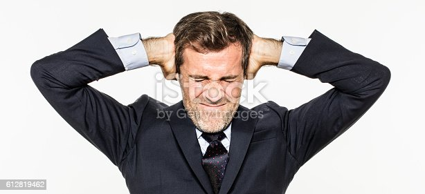 istock annoyed young business man covering his ears from corporate burnout 612819462