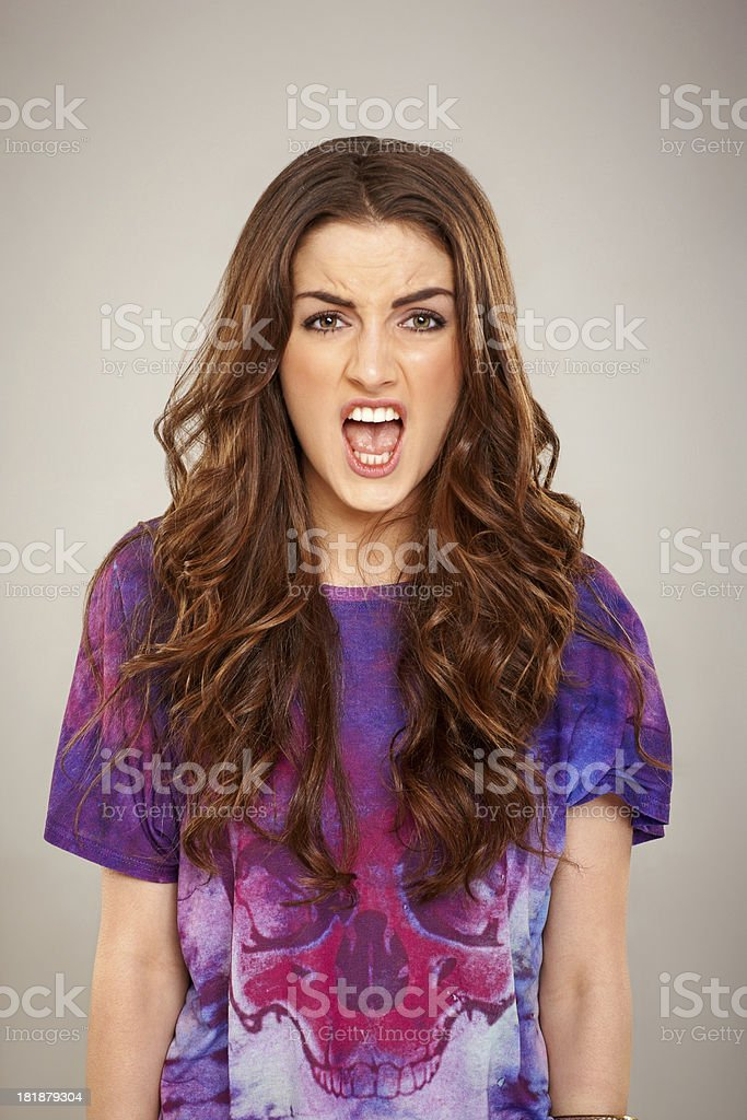 Annoyed young woman screaming royalty-free stock photo