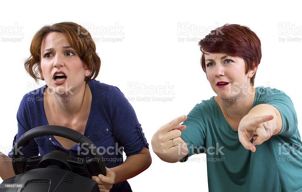 Annoying female passenger by being a backseat driver royalty-free stock photo