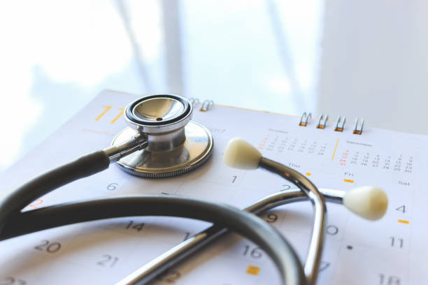 annual checkup concept. stethoscope on the calendar with soft-focus and over light in the background stock photo
