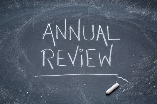 Annual review blackboard sign Annual review sign - white chalk messy handwriting on a blackboard annual event stock pictures, royalty-free photos & images