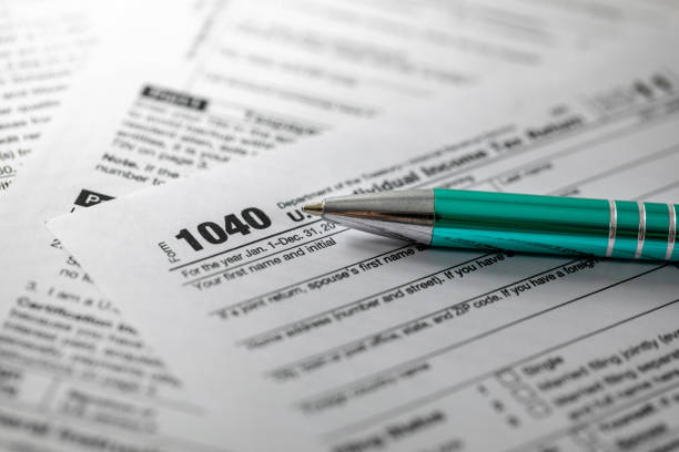 annual tax form 1040 and pen stock photo