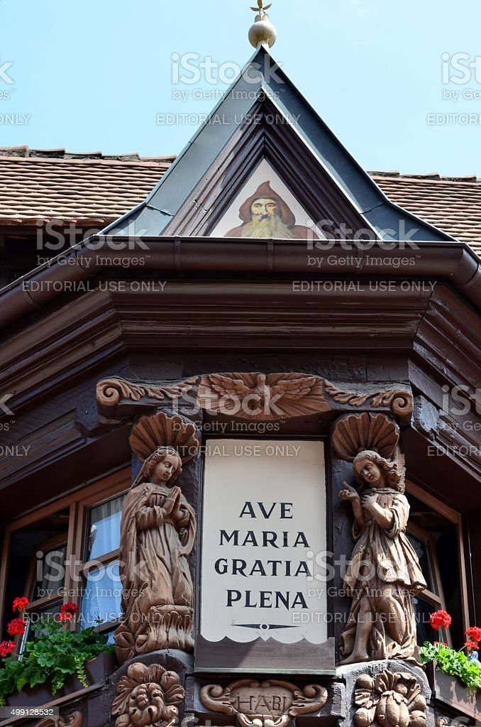 Annunciation in Ribeauville: Wooden Sculptures and Picture in Façade stock photo
