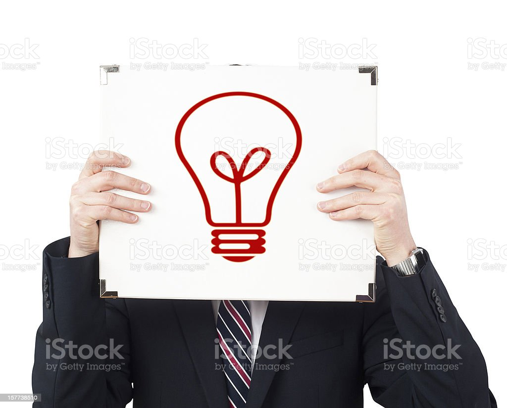 Anonymous businessman has an idea with bulb instead of face royalty-free stock photo