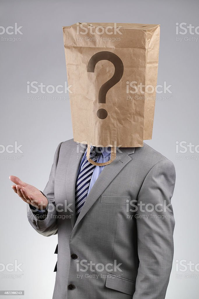 Anonymous businessman with paper bag on his head stock photo