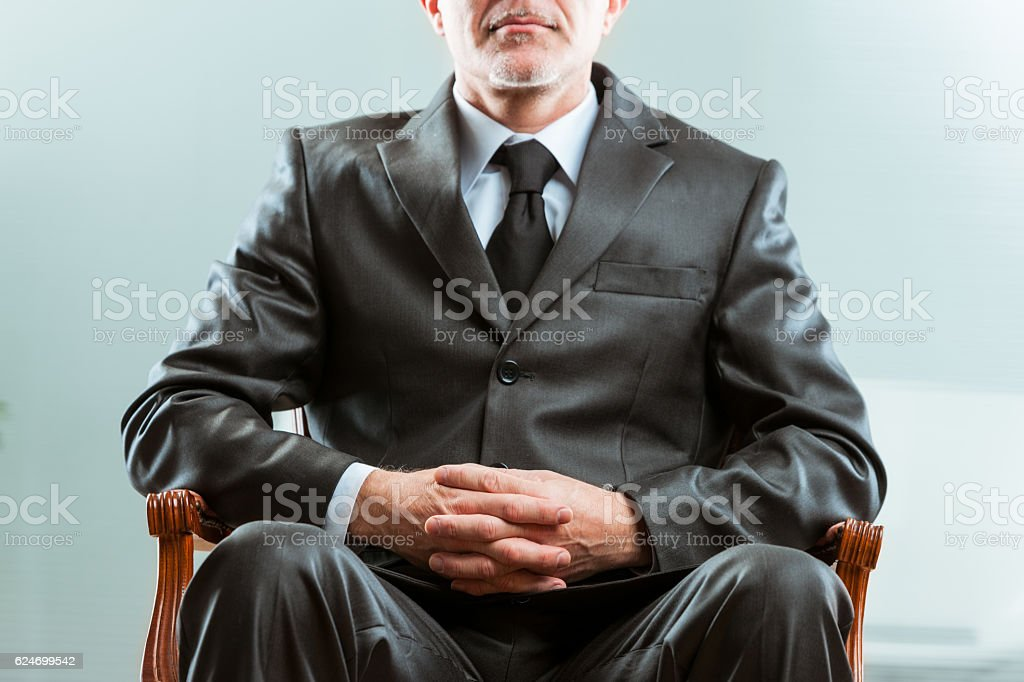 anonymous chairman on his chair stock photo
