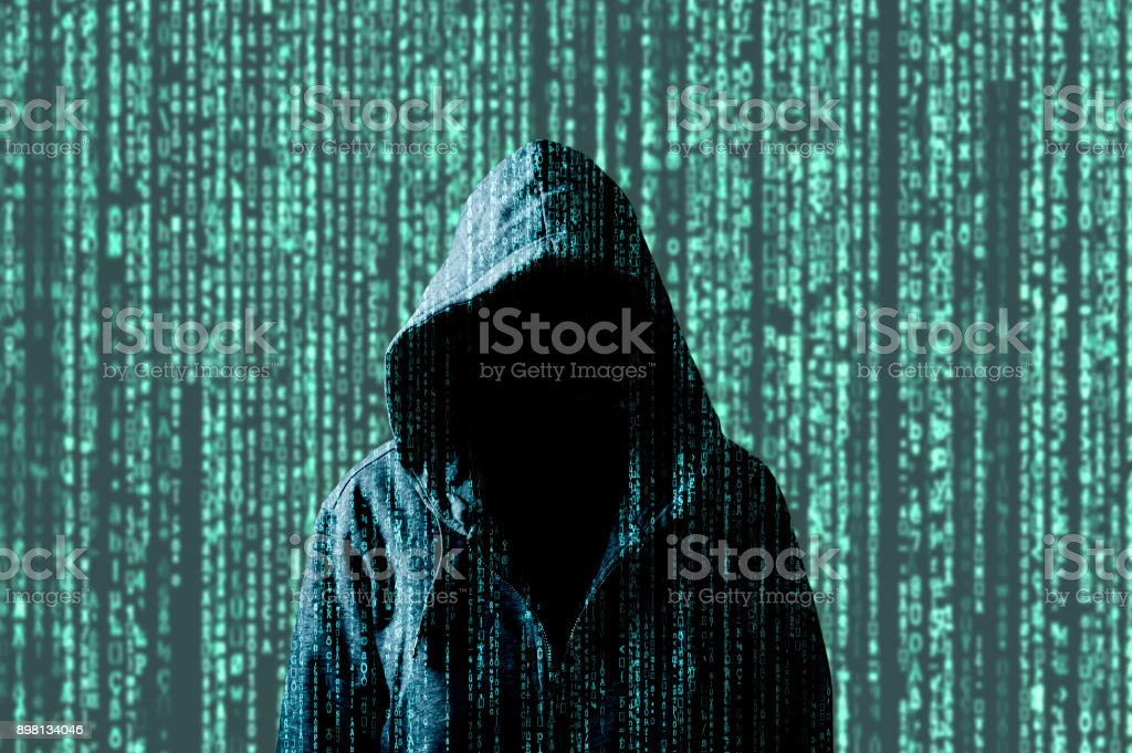 Anonymous computer hacker stock photo