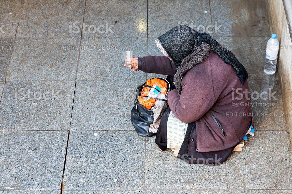 Anonymous female beggar stock photo