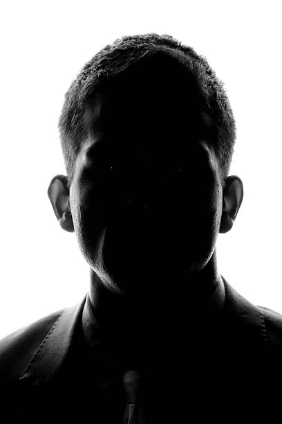 Anonymous - Front Silhouette Silhouette of a young man looking looking at the camera. generic description stock pictures, royalty-free photos & images