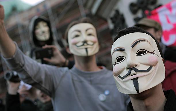 anónimo grupo - anonymous red activista fotografías e imágenes de stock