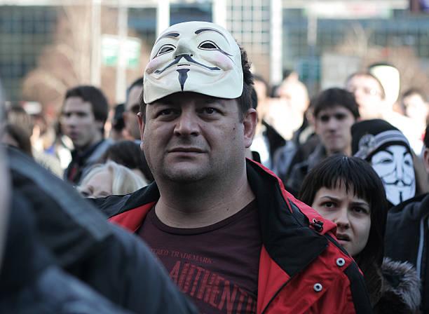 anónimo identidad reveló - anonymous red activista fotografías e imágenes de stock