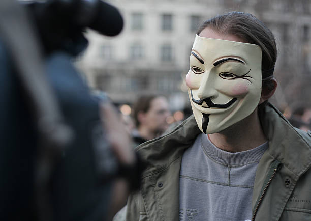 anonymous interview - guy fawkes mask stock photos and pictures