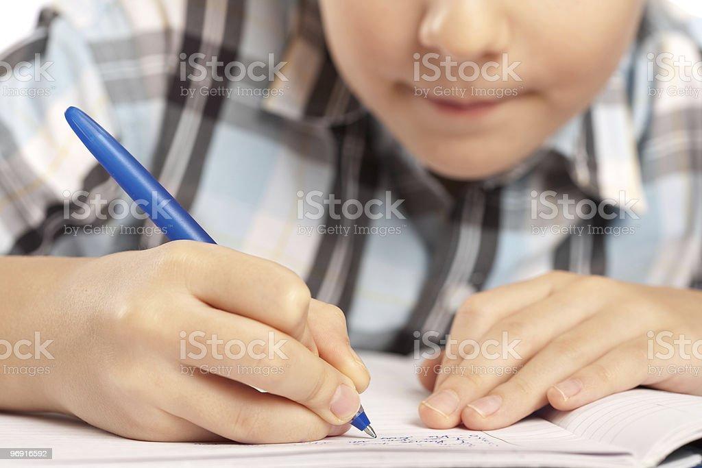 Anonymous kid doing homework royalty-free stock photo