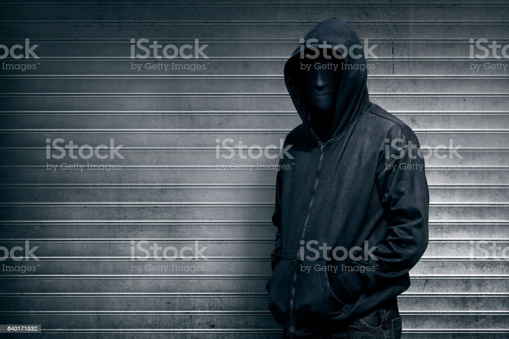 Anonymous man on grey shutter door – Foto