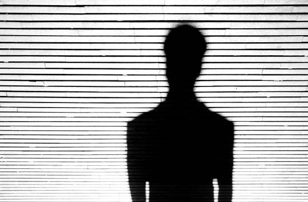 Anonymous person portrait silhouette Anonymous person portrait silhouette in black and white on patterned background stranger stock pictures, royalty-free photos & images