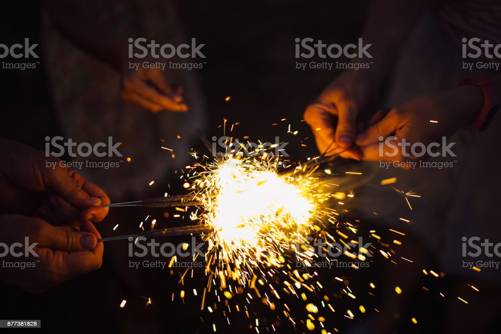 Anonymous person with burning firework stock photo