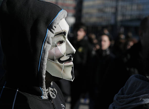 anonymous protester - guy fawkes mask stock photos and pictures