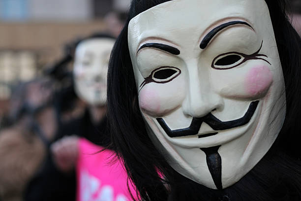 anonyme protesters - guy fawkes maske stock-fotos und bilder
