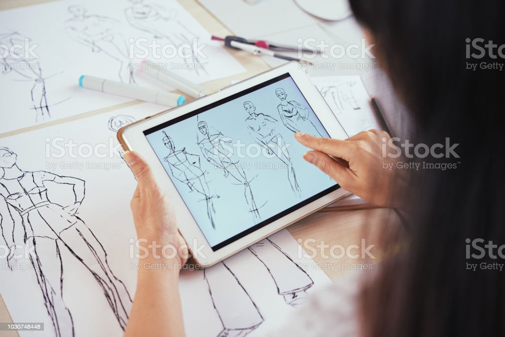 Anonymous Tailor Scrolling Sketches On Tablet Stock Photo Download Image Now Istock