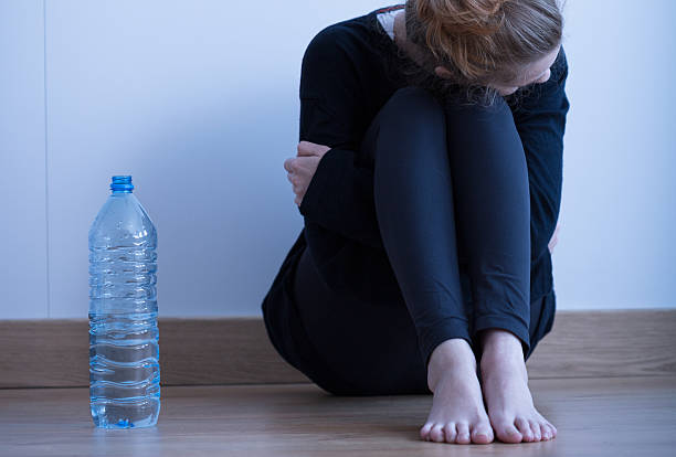 Anorectic girl and water stock photo