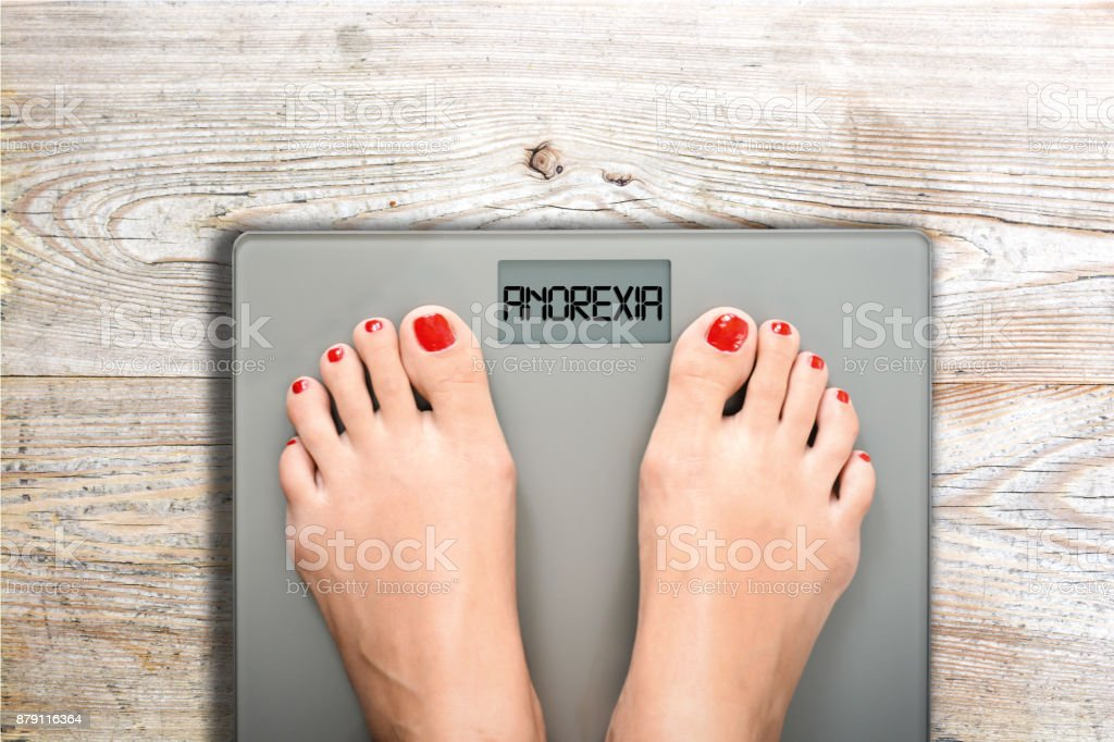 Anorexia text on weight scale, eating disorder as serious mental illness concept stock photo