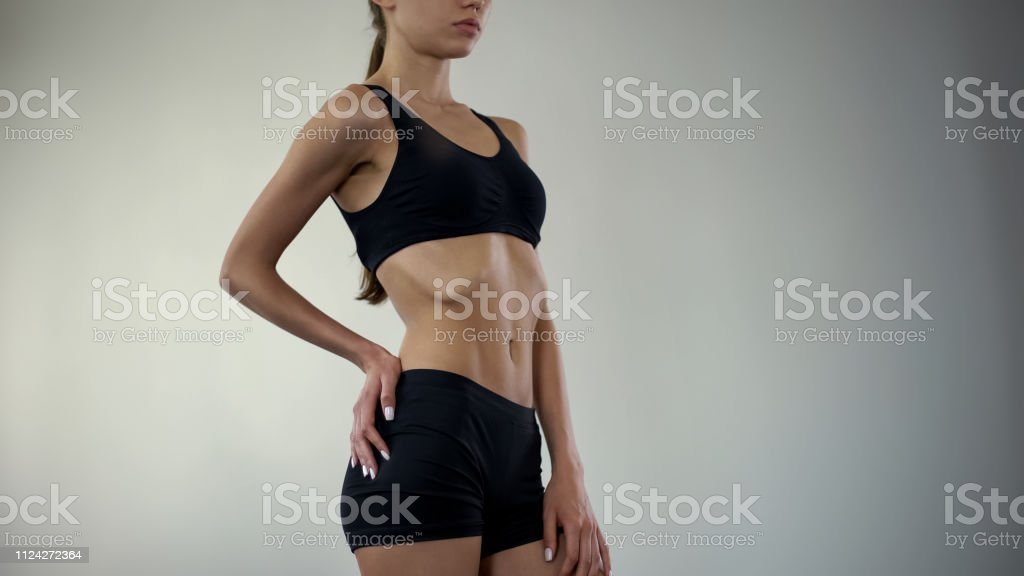 Anorexic girl in lingerie poses for camera, no fat layer, weight loss...