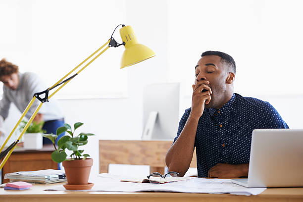 Another office day... Yawn! stock photo