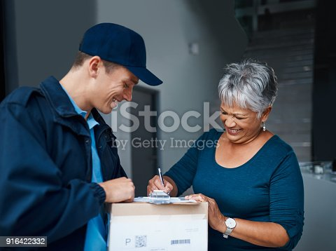 Cropped shot of a handsome young man delivering a package to a customer