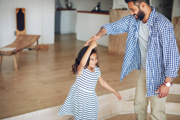 another twirl, dad! - father and daughter stock photos and pictures
