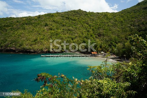 Black-sand beach Anse Noire surrounded by forest, in Les Anses-d'Arlet, Martinique