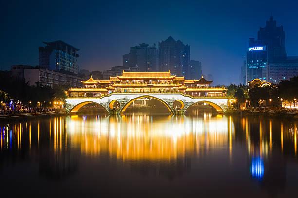 anshun bridge ablaze with lights anshun bridge in chengdu at night , China. ablaze stock pictures, royalty-free photos & images